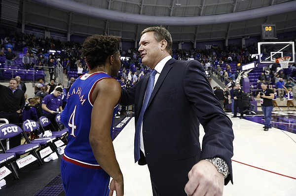 Kansas head coach Bill Self congratulates Kansas guard Devonte' Graham (4) after the Jayhawks' 88-84 win, Saturday, Jan. 6, 2018 at Schollmaier Arena.