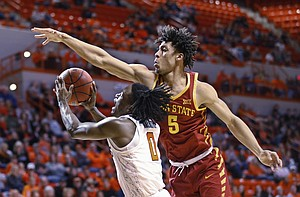 Oklahoma State guard Brandon Averette (0) is fouled by Iowa State guard Lindell Wigginton (5) as he shoots in the first half of an NCAA college basketball game in Stillwater, Okla., Saturday, Jan. 6, 2018.