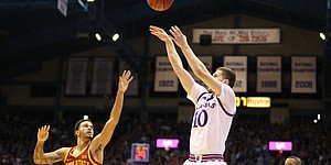 Kansas guard Sviatoslav Mykhailiuk (10) puts up a three from the corner over Iowa State guard Nick Weiler-Babb (1) during the first half, Tuesday, Jan. 9, 2018 at Allen Fieldhouse.