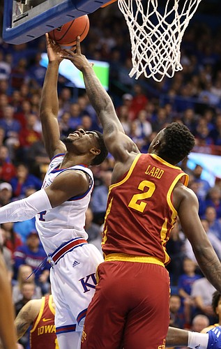 Kansas guard Malik Newman (14) has a shot stuffed by Iowa State forward Cameron Lard (2) during the first half, Tuesday, Jan. 9, 2018 at Allen Fieldhouse.