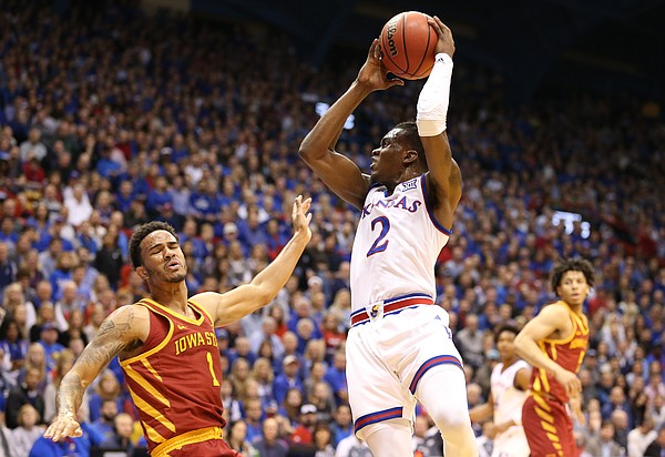 Kansas guard Lagerald Vick (2) sends Iowa State guard Nick Weiler-Babb (1) to the floor after a charge during the first half, Tuesday, Jan. 9, 2018 at Allen Fieldhouse.