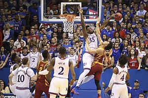 Kansas center Udoka Azubuike (35) rejects a shot from Iowa State guard Lindell Wigginton (5) during the first half, Tuesday, Jan. 9, 2018 at Allen Fieldhouse.