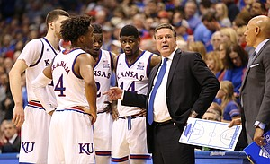 Kansas head coach Bill Self brings in the Jayhawks during a timeout in the second half, Tuesday, Jan. 9, 2018 at Allen Fieldhouse.