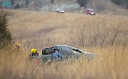 Crews work the scene of a single-vehicle, rollover accident off of Kansas Highway 10 near the youth sports complex on Tuesday, Jan. 9, 2018. The woman driving the pickup was flown to a Topeka hospital.