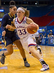 Kansas junior guard Kylee Kopatich (33) fights to get around West Virgina's Chania Ray (12) late in the second quarter of Wednesday's game at Allen Fieldhouse.