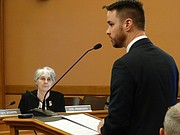 Sen. Marci Francisco, D-Lawrence, listens as Lawrence, an assistant to the Lawrence City Manager, briefs the Senate Utilities Committee Thursday about the city's decision to dispose of nitrate-contaminated water from the former Farmland Industries fertilizer plant into the Kansas River.