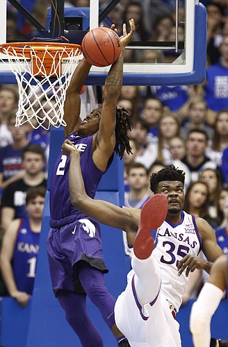 Kansas center Udoka Azubuike (35) loses his footing as Kansas State guard Cartier Diarra (2) goes up to the bucket during the second half, Saturday, Jan. 13, 2018 at Allen Fieldhouse.