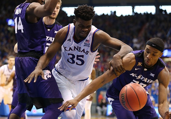 Kansas center Udoka Azubuike (35) wrestles for position on a loose ball with Kansas State forward Xavier Sneed (20) during the second half, Saturday, Jan. 13, 2018 at Allen Fieldhouse.