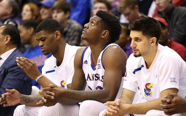 Kansas forward Silvio De Sousa (22) watches from the bench between Kansas forward Billy Preston, left, and Kansas guard Sam Cunliffe during the second half, Saturday, Jan. 13, 2018 at Allen Fieldhouse.