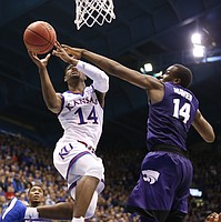 Kansas guard Malik Newman (14) is fouled on the shot by Kansas State forward Makol Mawien (14) with seconds remaining during the second half, Saturday, Jan. 13, 2018 at Allen Fieldhouse.