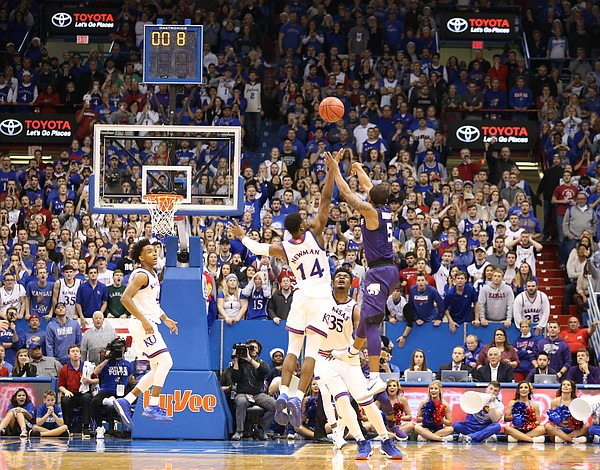 Kansas State guard Barry Brown (5) puts up a three defended by Kansas guard Malik Newman (14) with less than a second remaining in regulation, Saturday, Jan. 13, 2018 at Allen Fieldhouse.