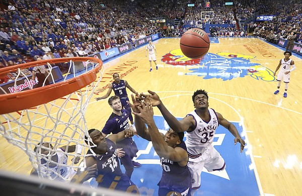 Kansas center Udoka Azubuike (35) battles with Kansas State forward Xavier Sneed (20) for a rebound during the second half, Saturday, Jan. 13, 2018 at Allen Fieldhouse.