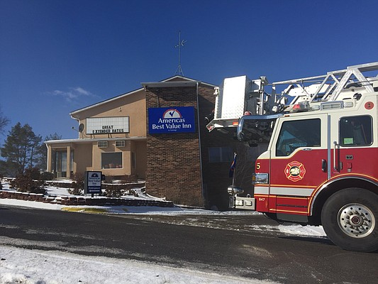 Lawrence firefighters respond to a reported fire at America's Best Value Inn, 515 McDonald Drive, Monday, Jan. 15, 2018.