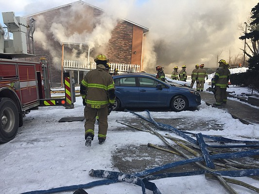 Lawrence firefighters watch a fire at America's Best Value Inn, 515 McDonald Drive, Monday, Jan. 15, 2018.