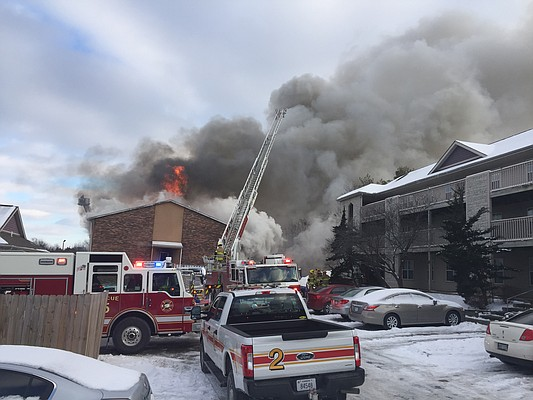 Lawrence firefighters battle a fire at America's Best Value Inn, 515 McDonald Drive, Monday, Jan. 15, 2018.