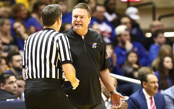 Kansas head coach Bill Self argues over a call with an official during the first half, Monday, Jan. 15, 2018 at WVU Coliseum in Morgantown, West Virginia.