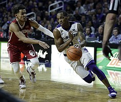 Kansas State guard Barry Brown (5) drives on Oklahoma guard Trae Young (11) during the second half of an NCAA college basketball game in Manhattan, Kan., Tuesday, Jan. 16, 2018. (AP Photo/Orlin Wagner)