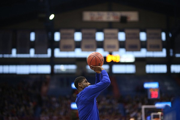 Kansas sophomore guard Malik Newman fires a shot during pre-game warmups prior to Saturday's game against Baylor at Allen Fieldhouse.