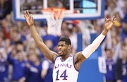 Kansas guard Malik Newman (14) raises up his arms after a three during the first half, Saturday, Jan. 20, 2018 at Allen Fieldhouse.