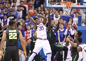 Kansas center Udoka Azubuike (35) rips a rebound away from Baylor center Jo Lual-Acuil Jr. during the first half, Saturday, Jan. 20, 2018 at Allen Fieldhouse.