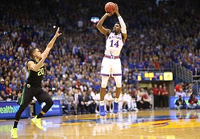 Kansas guard Malik Newman (14) pulls up for a three against Baylor guard Manu Lecomte during the first half, Saturday, Jan. 20, 2018 at Allen Fieldhouse.