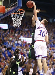 Kansas guard Sviatoslav Mykhailiuk (10) floats in for a posterizing dunk during the first half, Saturday, Jan. 20, 2018 at Allen Fieldhouse.