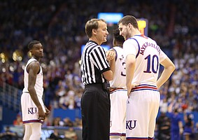 Kansas guard Sviatoslav Mykhailiuk (10) has a laugh with official John Higgins during the second half, Saturday, Jan. 20, 2018 at Allen Fieldhouse.