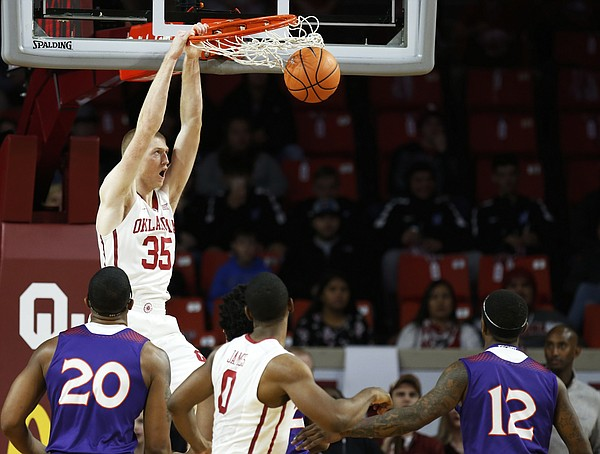 Oklahoma forward Brady Manek (35) dunks in the first half of an NCAA college basketball game against Northwestern State in Norman, Okla., Tuesday, Dec. 19, 2017. Oklahoma won 105-68.