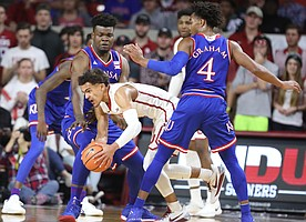 Kansas guard Devonte' Graham (4) and Kansas center Udoka Azubuike (35) look to tie up Oklahoma guard Trae Young (11) during the first half at Lloyd Noble Center on Tuesday, Jan. 23, 2018 in Norman, Oklahoma.