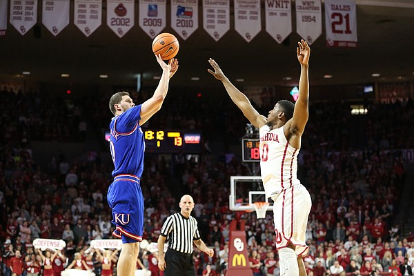 Kansas guard Sviatoslav Mykhailiuk (10) pulls up for a three in front of Oklahoma guard Christian James (0) during the first half at Lloyd Noble Center on Tuesday, Jan. 23, 2018 in Norman, Oklahoma.