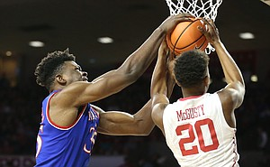 Kansas center Udoka Azubuike (35) battles for a ball with Oklahoma guard Kameron McGusty (20) during the first half at Lloyd Noble Center on Tuesday, Jan. 23, 2018 in Norman, Oklahoma.