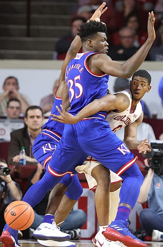 Oklahoma guard Christian James (0) hooks a pass behind Kansas center Udoka Azubuike (35) during the second half at Lloyd Noble Center on Tuesday, Jan. 23, 2018 in Norman, Oklahoma.