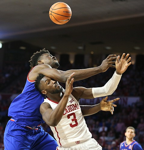 Kansas center Udoka Azubuike (35) and Oklahoma forward Khadeem Lattin (3) battle for position in the paint during the second half at Lloyd Noble Center on Tuesday, Jan. 23, 2018 in Norman, Oklahoma.