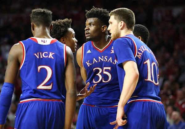 Kansas players huddle around Kansas center Udoka Azubuike (35) before a one-and-one during the second half at Lloyd Noble Center on Tuesday, Jan. 23, 2018 in Norman, Oklahoma.