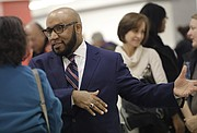Anthony Lewis, a current assistant superintendent in the Kansas City, Mo. school district, and one of two finalists for the Lawrence school district's superintendent position, participates in a meet-and-greet in the Lawrence High School cafeteria Tuesday, Jan. 23, 2018.