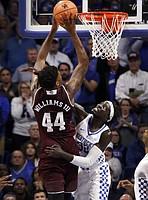 Kentucky's Wenyen Gabriel, right, fouls Texas A&M's Robert Williams (44) during the second half of an NCAA college basketball game, Tuesday, Jan. 9, 2018, in Lexington, Ky. Kentucky won 74-73.