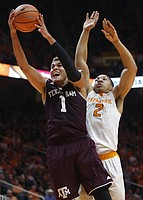 Texas A&M forward DJ Hogg (1) is defended under the basket by Tennessee forward Grant Williams (2) during the second half of an NCAA college basketball game Saturday, Jan. 13, 2018, in Knoxville, Tenn.
