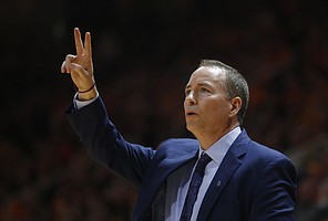 Texas A&M head coach Billy Kennedy yells directions to his team in the first half of an NCAA college basketball game against Tennessee on Saturday, Jan. 13, 2018, in Knoxville, Tenn.