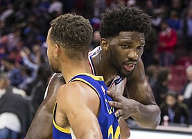 Philadelphia 76ers' Joel Embiid, of Cameroon, right, gives Golden State Warriors' Stephen Curry, left, a hug following the second half of an NBA basketball game, Saturday, Nov. 18, 2017, in Philadelphia. The Warriors won 124-116. (AP Photo/Chris Szagola)