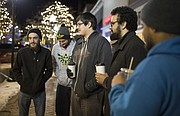 Topeka residents Charlie Gaito, left, Patrick Abbott, Ivan Bermudez, Jeremiah Brannan and Alex Stovall, who all say that they travel to Lawrence for food and entertainment, give their opinions about safety in Lawrence, Thursday, Jan. 18, 2018 along the 1000 block of Massachusetts Street.