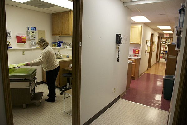 In this photo from Feb. 9, 2010, nurse Jeri Safarik gets one of the exam rooms ready at Health Care Access on its last day at its former 1920 Moodie Road location.