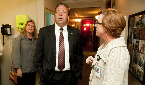 In this Oct. 20, 2010 photo, State Sen. Tom Holland, of Baldwin City, and his wife, Barbara, left, receive a tour of the Health Care Access clinic from Sally Monahan Zogry, then-development director.
