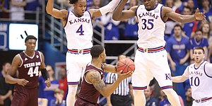 Kansas guard Devonte' Graham (4) and Kansas center Udoka Azubuike (35) elevate to defend against a pass from Texas A&M guard TJ Starks (2) during the first half, Saturday, Jan. 27, 2018 at Allen Fieldhouse.
