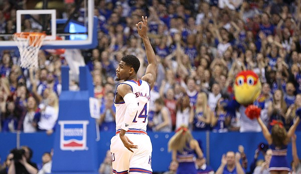 Kansas guard Malik Newman (14) raises his hand after sinking a three during the first half, Saturday, Jan. 27, 2018 at Allen Fieldhouse.