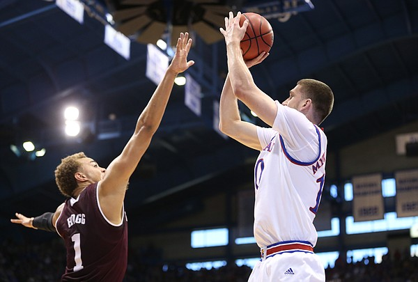Kansas guard Sviatoslav Mykhailiuk (10) puts up a three from the corner over Texas A&M forward DJ Hogg (1) during the first half, Saturday, Jan. 27, 2018 at Allen Fieldhouse.