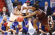Kansas guard Malik Newman (14) tries to knock a ball away from Texas A&M guard JJ Caldwell (4) during the second half, Saturday, Jan. 27, 2018 at Allen Fieldhouse.