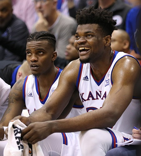 Kansas center Udoka Azubuike, right, has a laugh with Kansas guard Lagerald Vick during the second half, Saturday, Jan. 27, 2018 at Allen Fieldhouse.