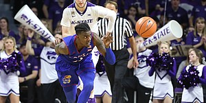 Kansas guard Lagerald Vick (2) chases a ball past Kansas State forward Dean Wade (32) during the first half, Monday, Jan. 29, 2018 at Bramlage Coliseum in Manhattan, Kan.