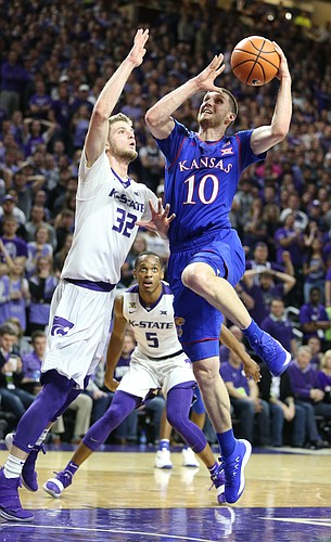 Kansas guard Sviatoslav Mykhailiuk (10) elevates to the bucket against Kansas State forward Dean Wade (32) during the first half, Monday, Jan. 29, 2018 at Bramlage Coliseum in Manhattan, Kan.