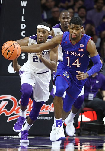 Kansas guard Malik Newman (14) runs the ball up the court past Kansas State forward Xavier Sneed (20) during the second half, Monday, Jan. 29, 2018 at Bramlage Coliseum in Manhattan, Kan.
